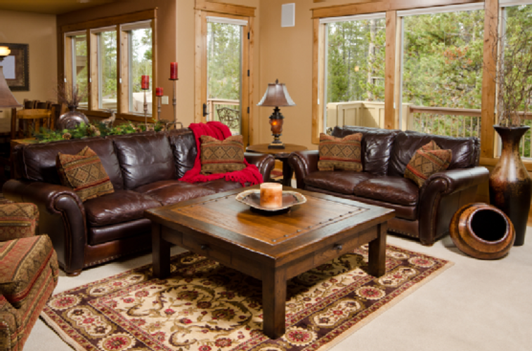 Living Room Cream Wall Dark Brown Leather Sofa Red Blanket ...