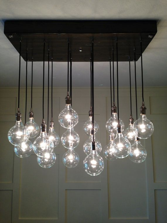 Custom industrial chandelier with modern glass pendants in polished nickel sockets hung from rayon cord attached