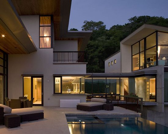 L shaped house and corner windows with cubed house for Corner house design