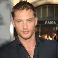 Tom Hardy... would be even hotter if he got his teeth fixed.   Would love to see him smile with a s**t eating grin.