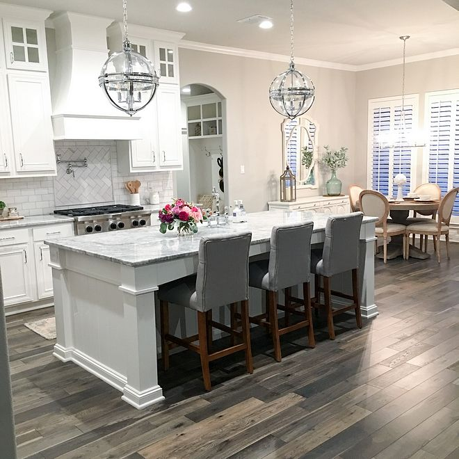 White Kitchen with grey-stained hardwood floors White Kitchen with ...