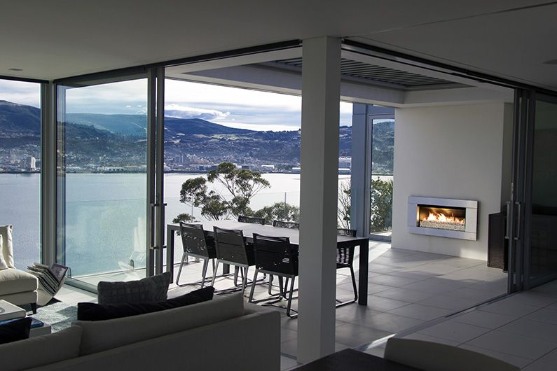 A beautiful indoor outdoor flow with an Escea outdoor gas fireplace ...