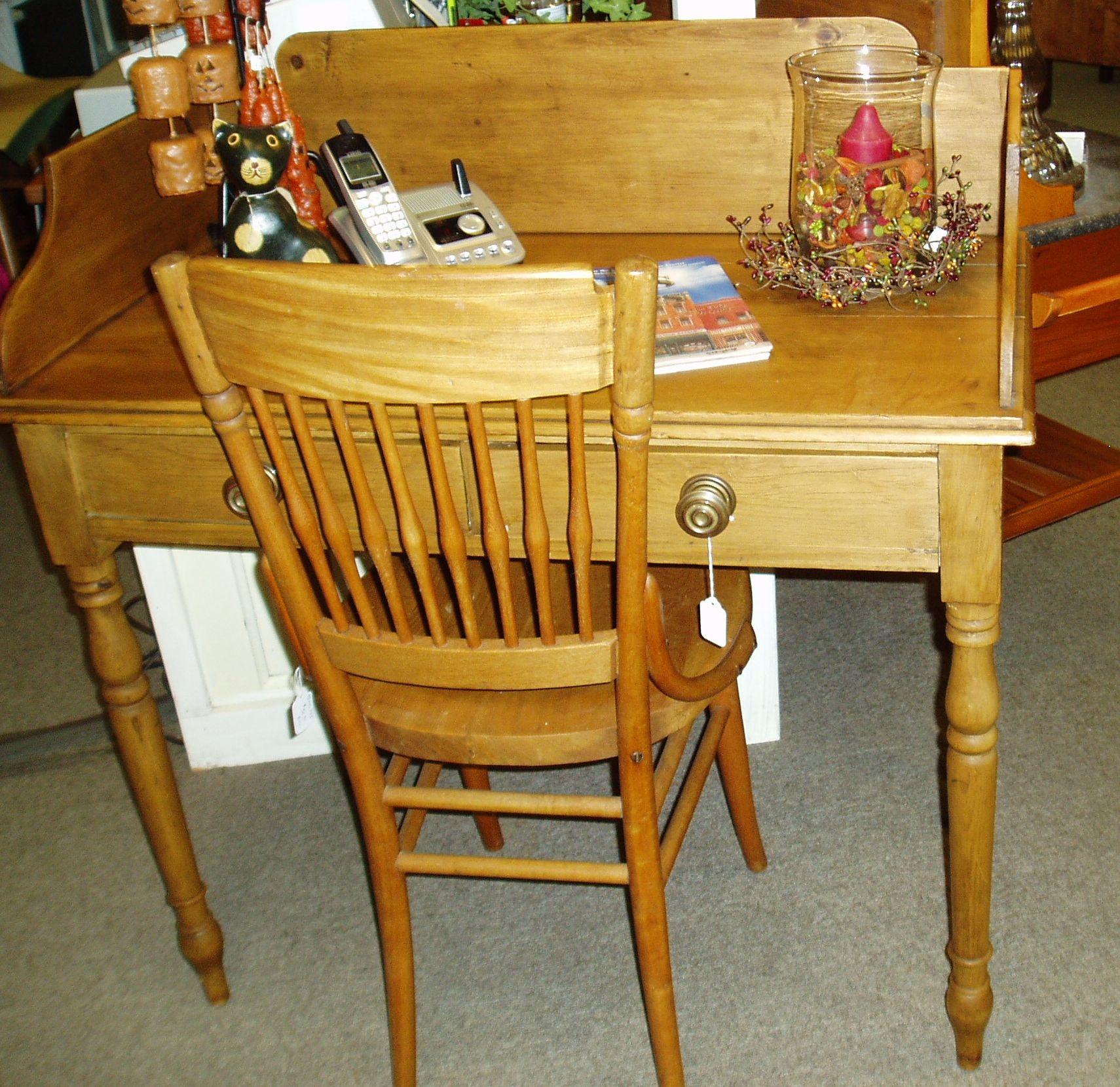 Compact pine writing desk and chair have simple lines and ...