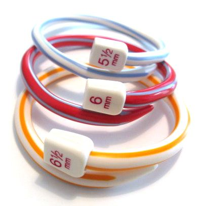 recycled knitting needles in bangles (by Plastic Girl)