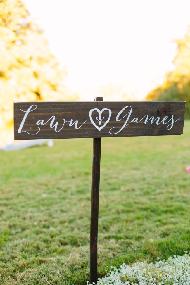 Lawn Games Wood Sign | Twilight Metallic Glam Wedding At Sacred Oaks at Camp Lucy Texas | Photograph by Al Gawlik Photography  http://storyboardwedding.com/twilight-metallic-glam-wedding-sacred-oak-camp-lucy-texas/
