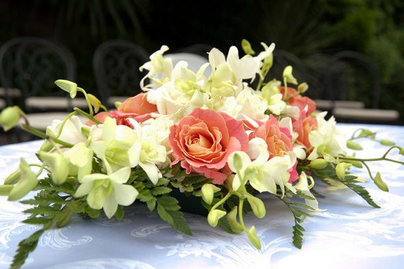 Coral and ivory wedding flowers centerpiece my