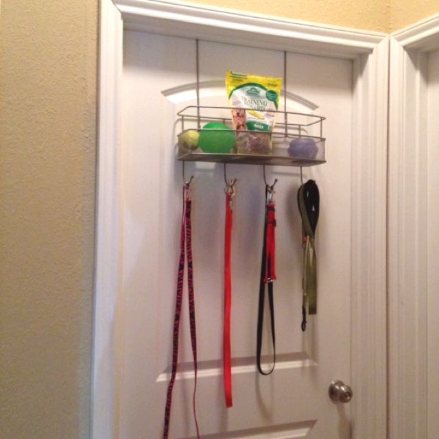 I used an over-the-door hanger on their bedroom door to centralize my dogs' leashes and treats.
