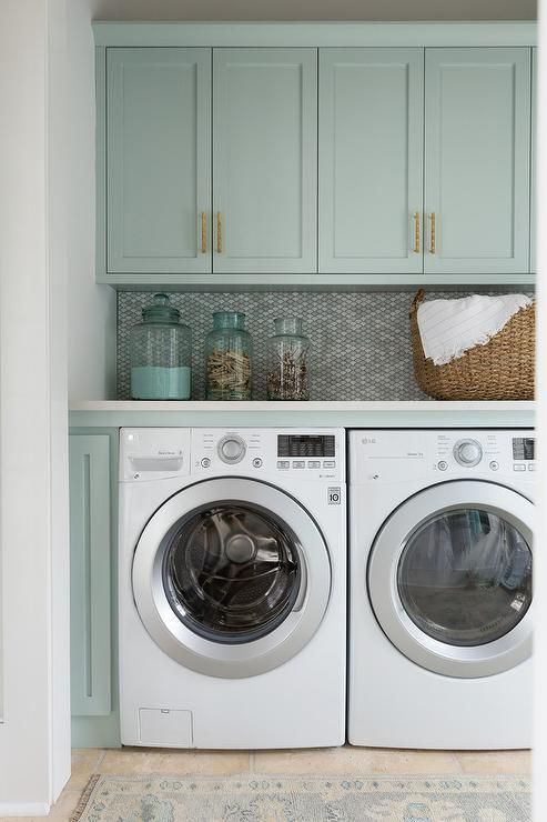 Laundry Room Backsplash gray green shaker cabinets adorned with brass pulls hang over a