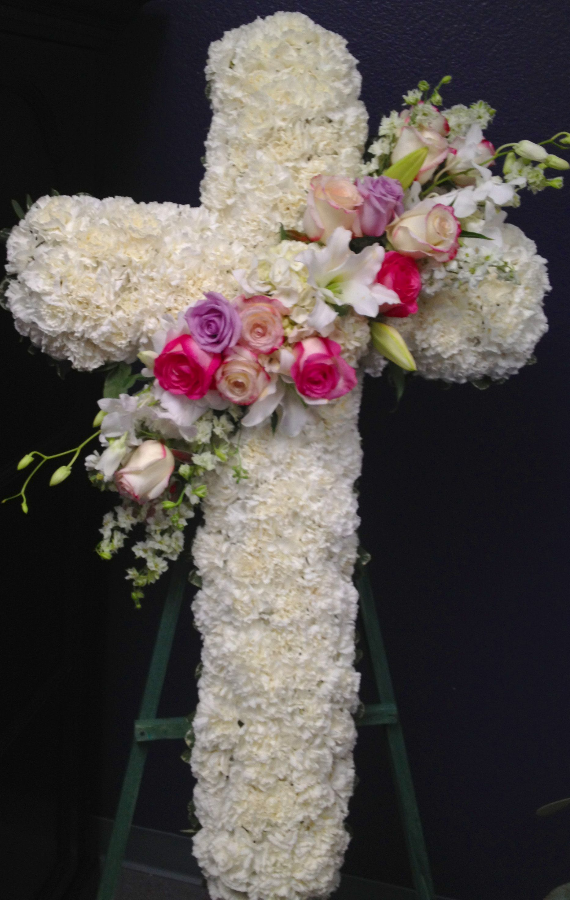 Unique flower arrangements pink and white cross sympathy flowers unique flower arrangements pink and white cross sympathy flowers izmirmasajfo Image collections