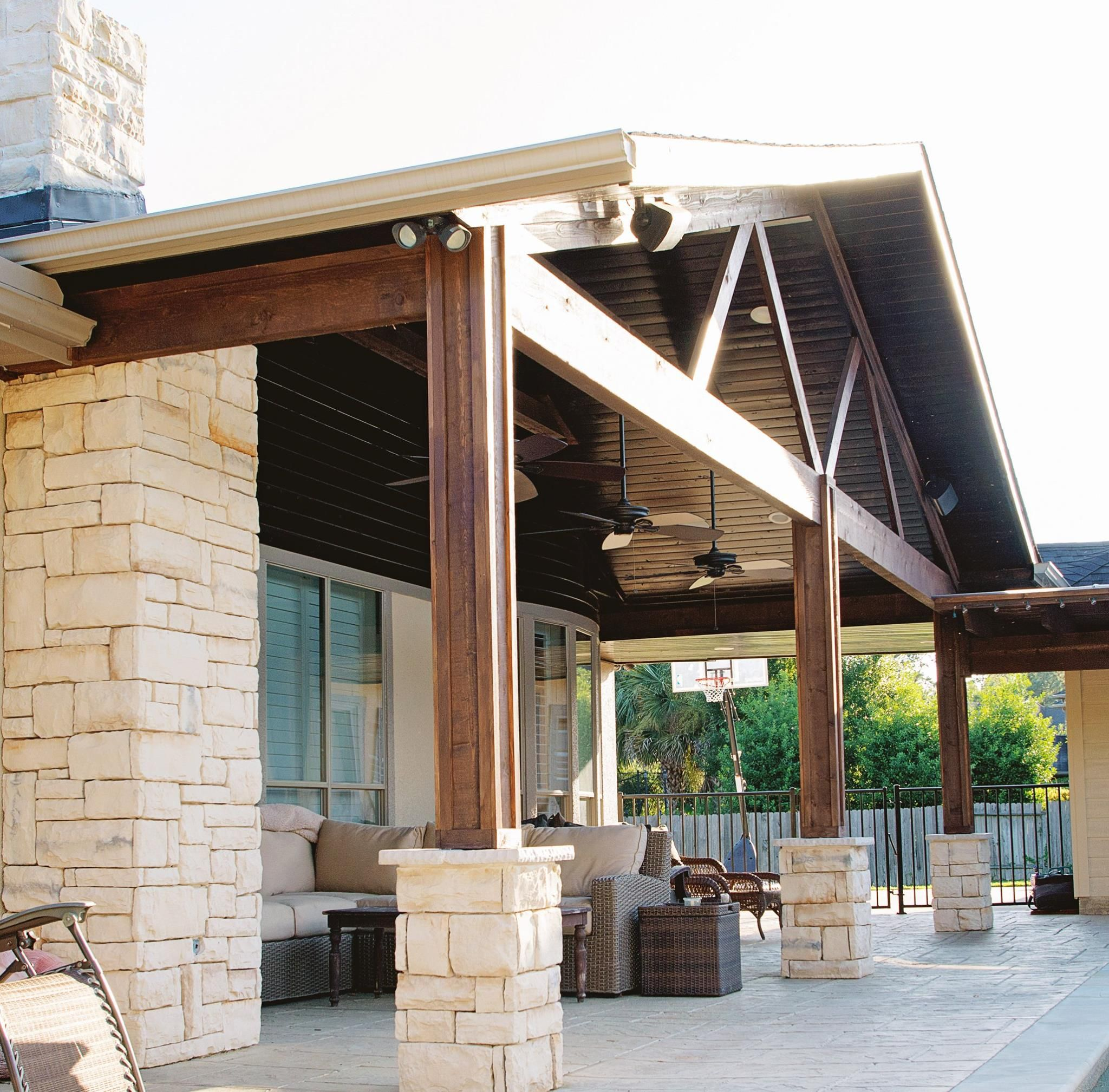 Covered patio and outdoor fireplace built by Houston s best patio
