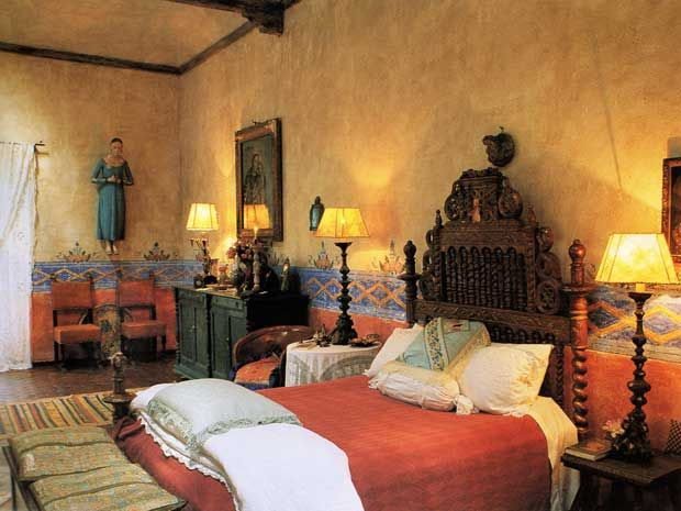 room in a hacienda whose walls are painted with the motifs of the nearby Atotonilco shrine, frequently referred to as Mexico's Sistine Chape...