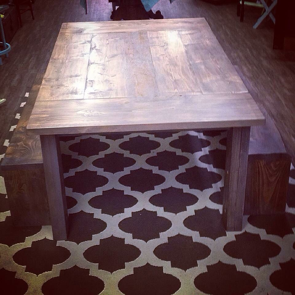 Two tone worn solid wood farmhouse table. Table