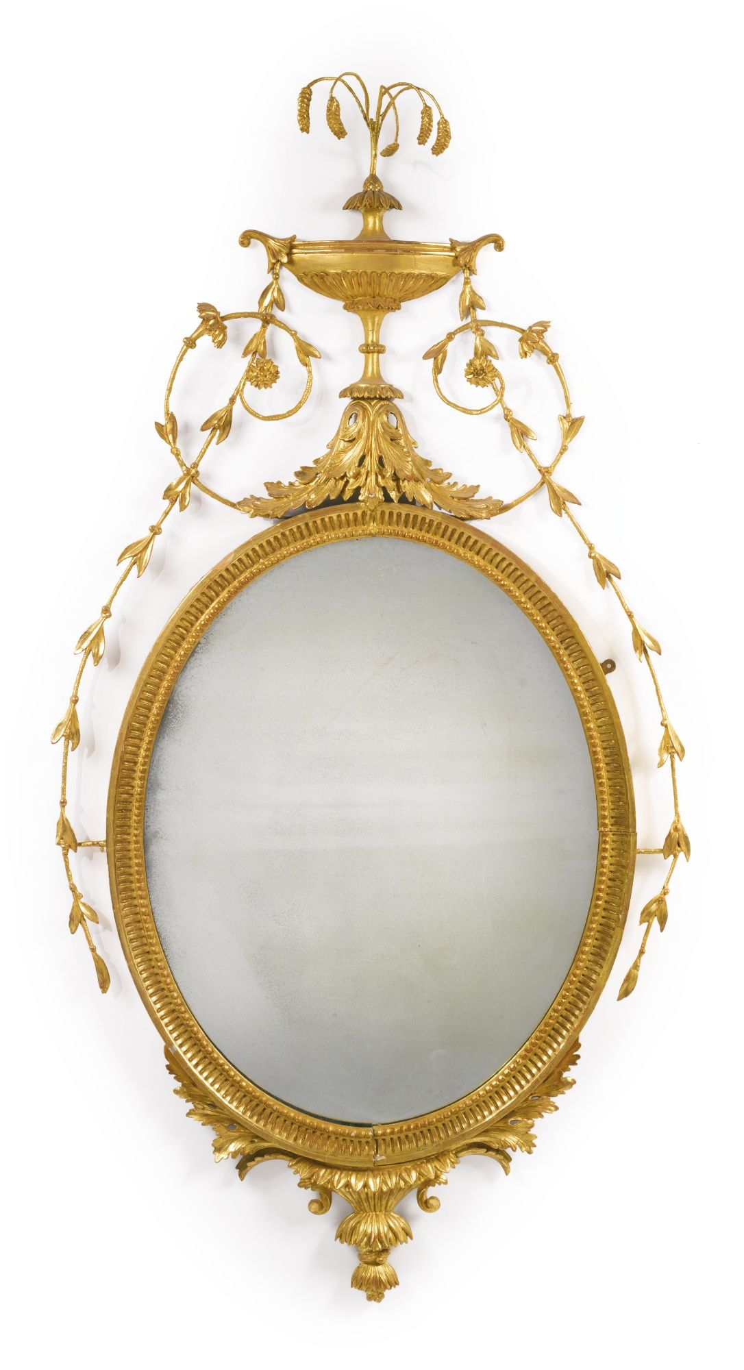 A George III giltwood and gilt-composition oval pier mirror circa ...
