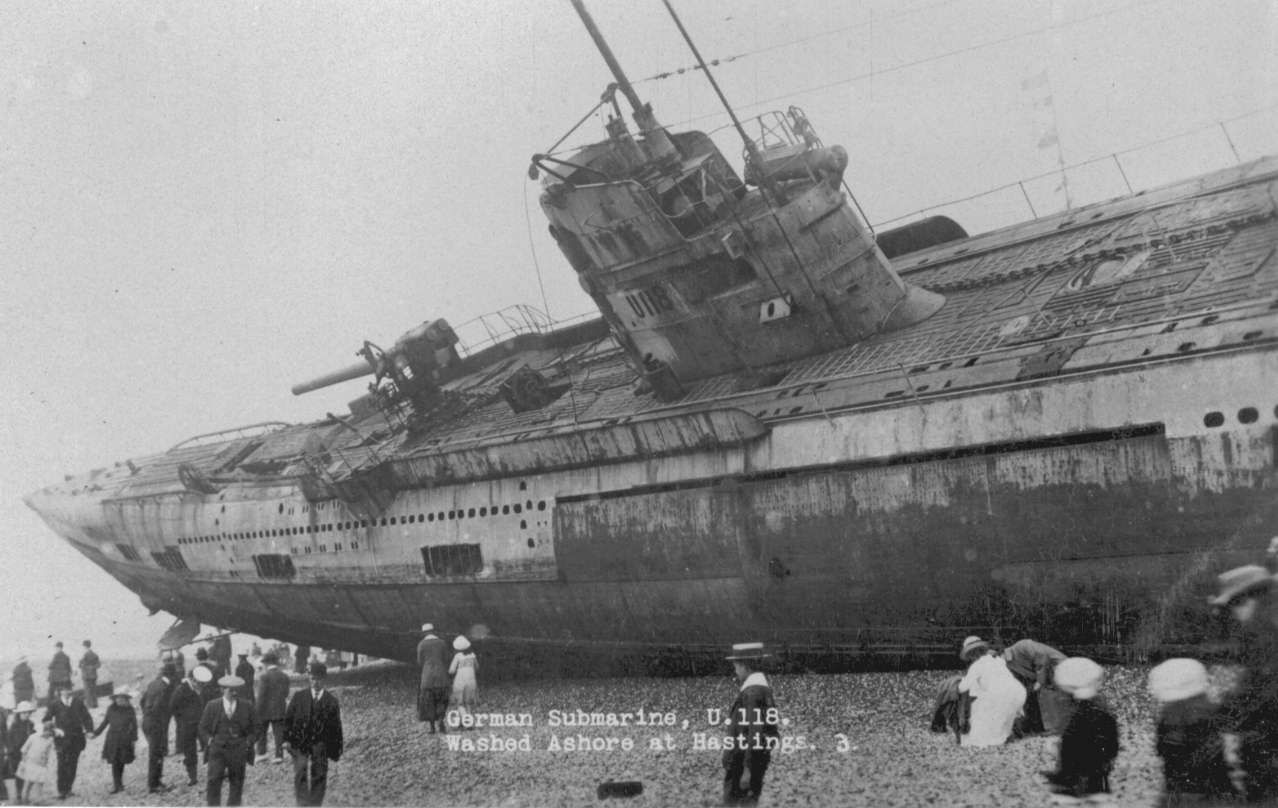 German U boats wash up on the shore of an English beach after World War 1. The U-boats were being towed back to England when the storm struck, severing the tow lines. Three U-boats washed up on English beaches where they sat until the English navy and salvage crews pulled them free. They were later scrapped.
