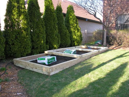 Building A Tiered Raised Vegetable Bed On A Slope Sloped Garden
