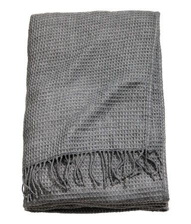 Dark gray. Twin bedspread in soft woven fabric with a waffled texture. Fringe at short sides.