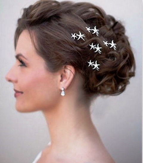 Beach wedding bride's hairstyle loose curl updo with starfish pins   ☀