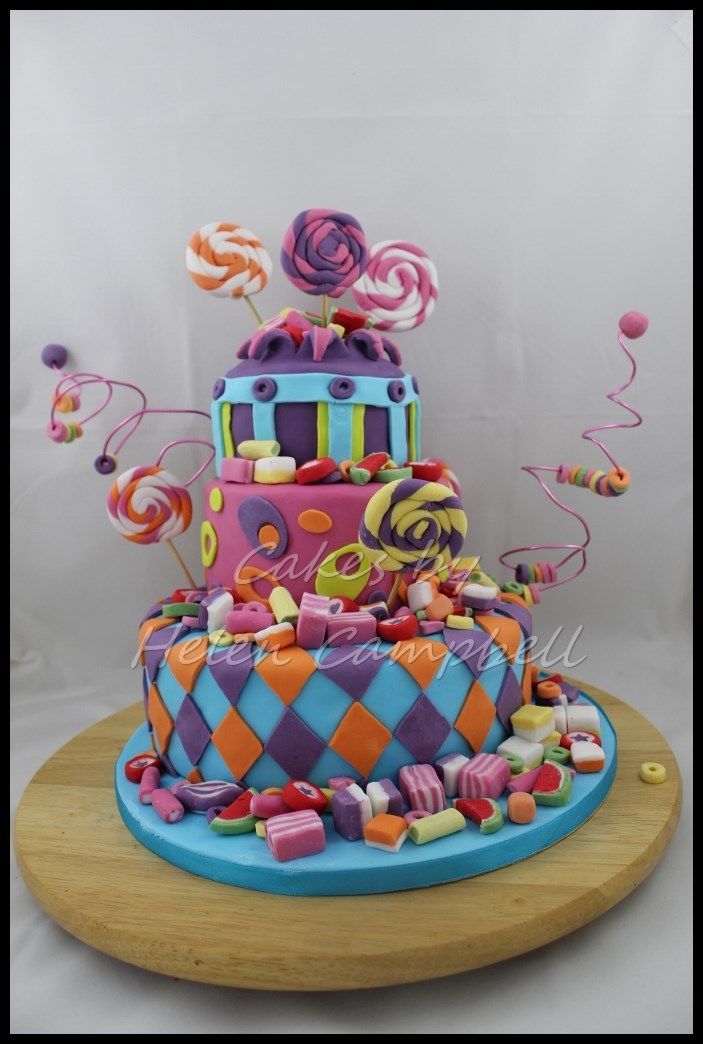 Three tier crazy candy cake. Find me on facebook at Cakes by Helen Campbell