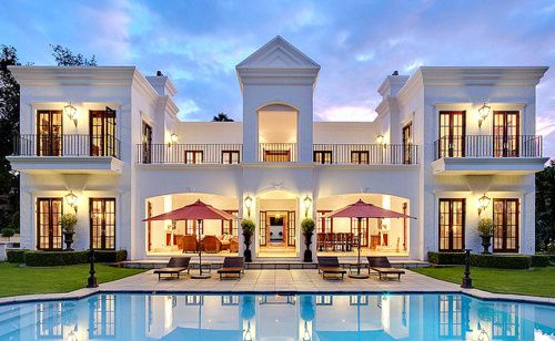 my dream house except there is a food bar to the side of the pool and a slide connecting the balcony to the pool also there is a water passage leading to
