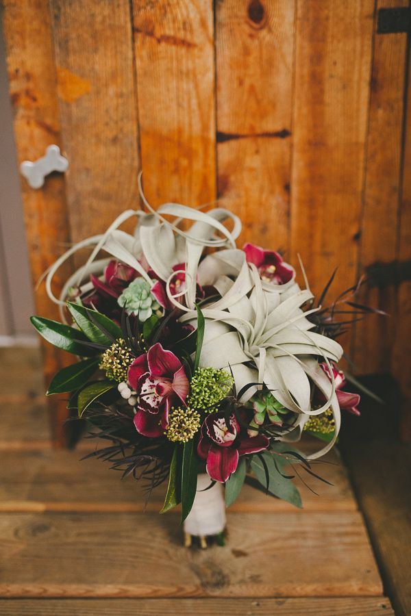 air plant bouquet, photo by Shari + Mike Photographers http://ruffledblog.com/pacific-northwest-rainforest-wedding #flowers #weddingbouquet #airplants