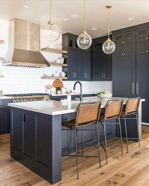 Modern Glass Pendant in Classic Kitchen Design with Dark Cabinets, Subway Tile & Sleek Appliances