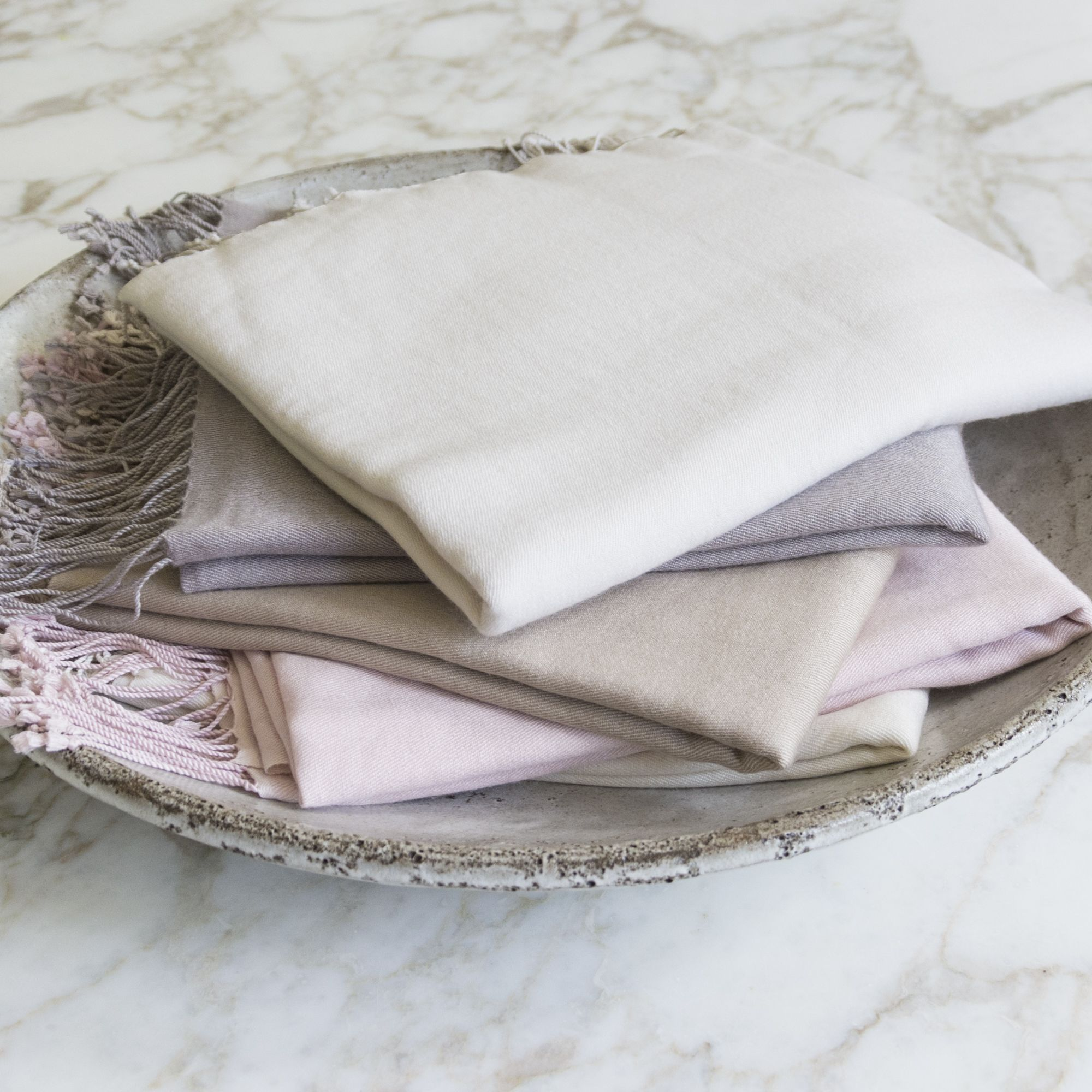 A quality pashmina is a true wardrobe staple, the perfect finishing touch for any number of outfits. This cashmere-silk blend shawl offers warmth, softness and the lustrous appeal of a luxury weave. For ultimate luxury and warmth, wrap yourself in pashmina.