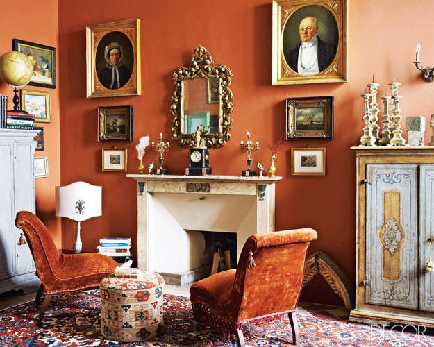 An antique Umbrian mirror hangs above a 19th-century mantel in the study.