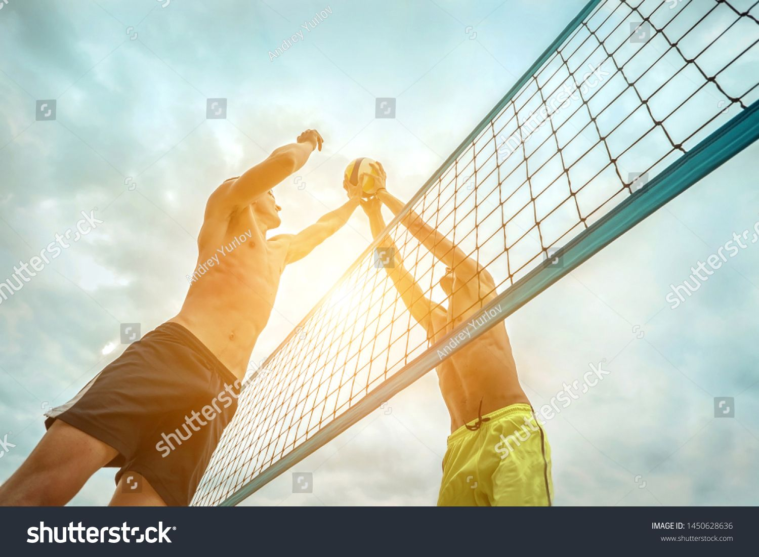 Beach Volleyball Players In Sunglasses In Action With Ball Under Sunlight Popular Dynamic Outdoor Sport For Peo In 2020 Beach Volleyball Volleyball Players Volleyball