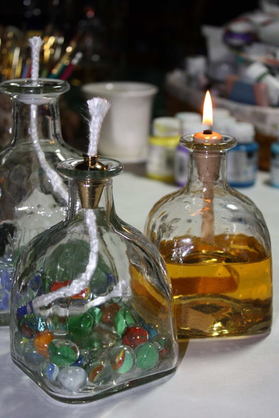 Repurposed some Patron bottles into oil lamps