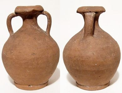 Ancient Roman, 3rd - 4th Century AD. Nice large two-handled jug. The body ovoid with well-turned foot, and flared mouth with thick angled lip.