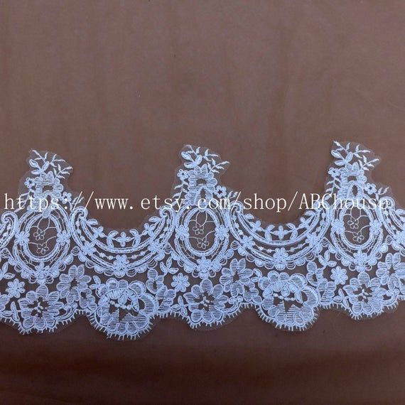 Photo of Good quality off white netting embroidery lace trim skeleton…