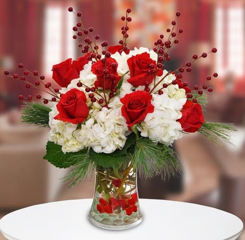 Vibrant Red Roses Highlight This Sophisticated Holiday Design Featuring White Hydran Christmas Flower Arrangements Christmas Floral Arrangements Holiday Flower