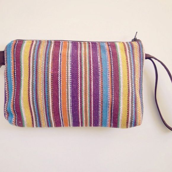 Multi-Color Striped Wristlet BRAND NEW, UNUSED multi-color striped wristlet perfect for small items. Use as a travel pouch or cosmetics bag. Bags Clutches & Wristlets