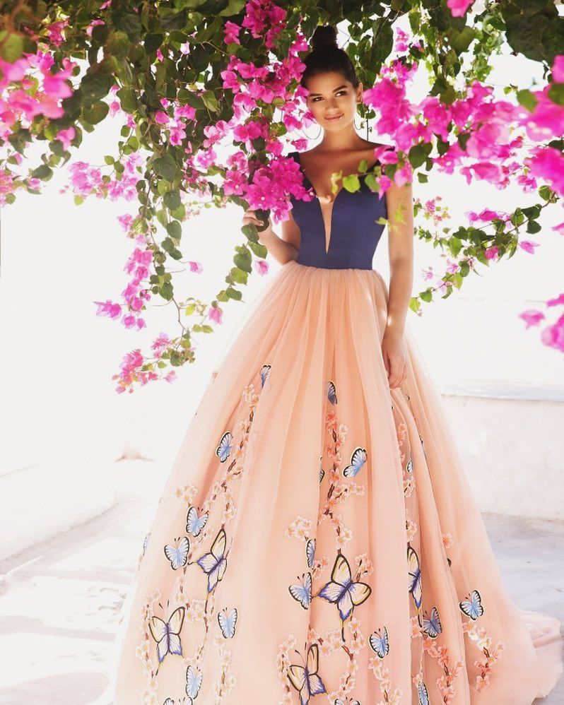 When navy blue meets peach the result of this crystal design gown