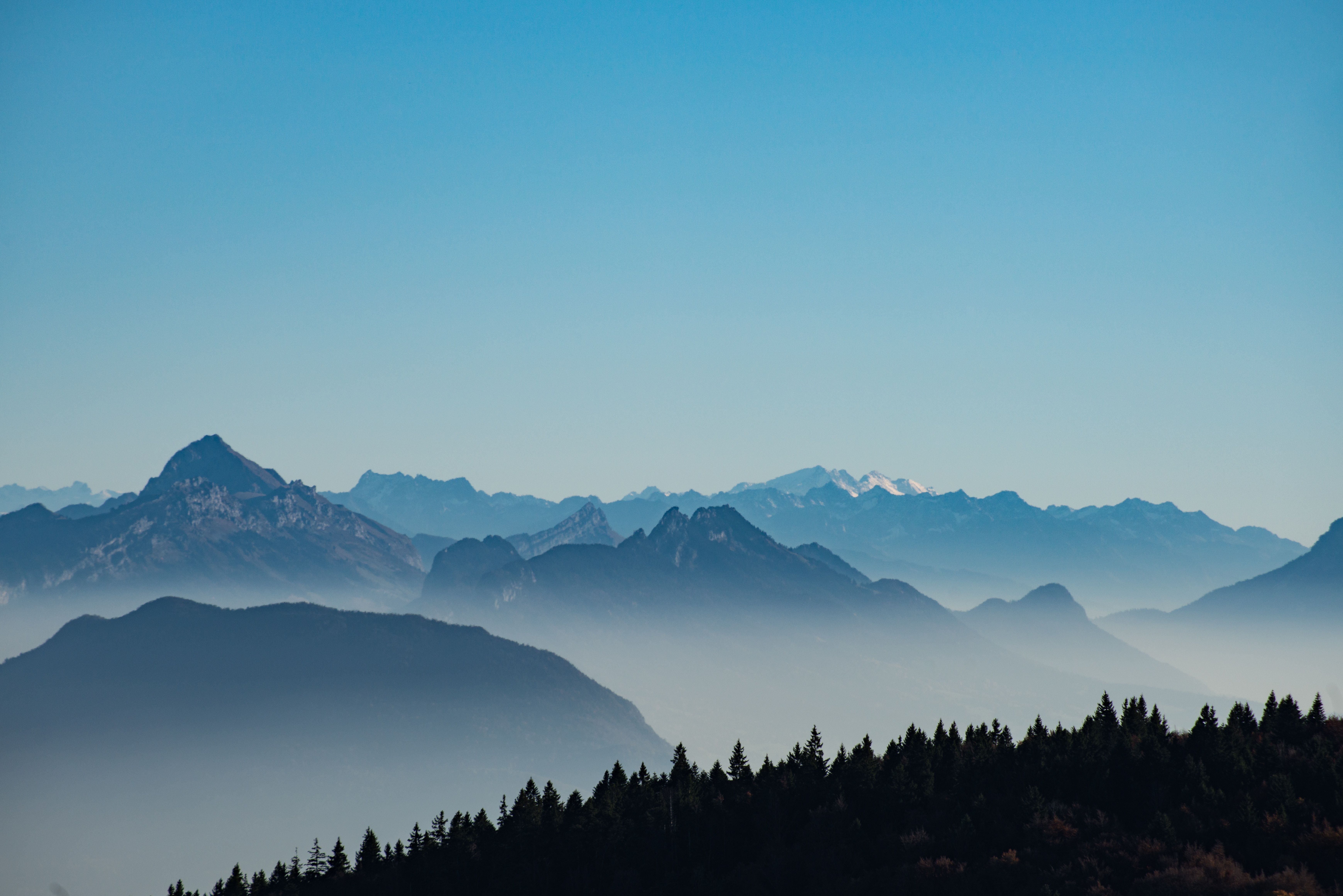 Hd Wallpaper A Mountain Range And Forest Against A Blue Sky In Saleve France Sunrise Mountain Fo Mountain Pictures Nature Photography Outdoor Pictures Sunrise morning fog mountain range dawn