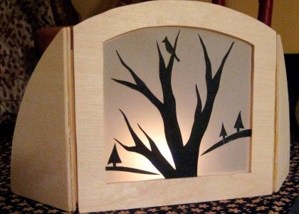 silhouette lantern tutorial--use photos of community or nature hike, printed on vellum?