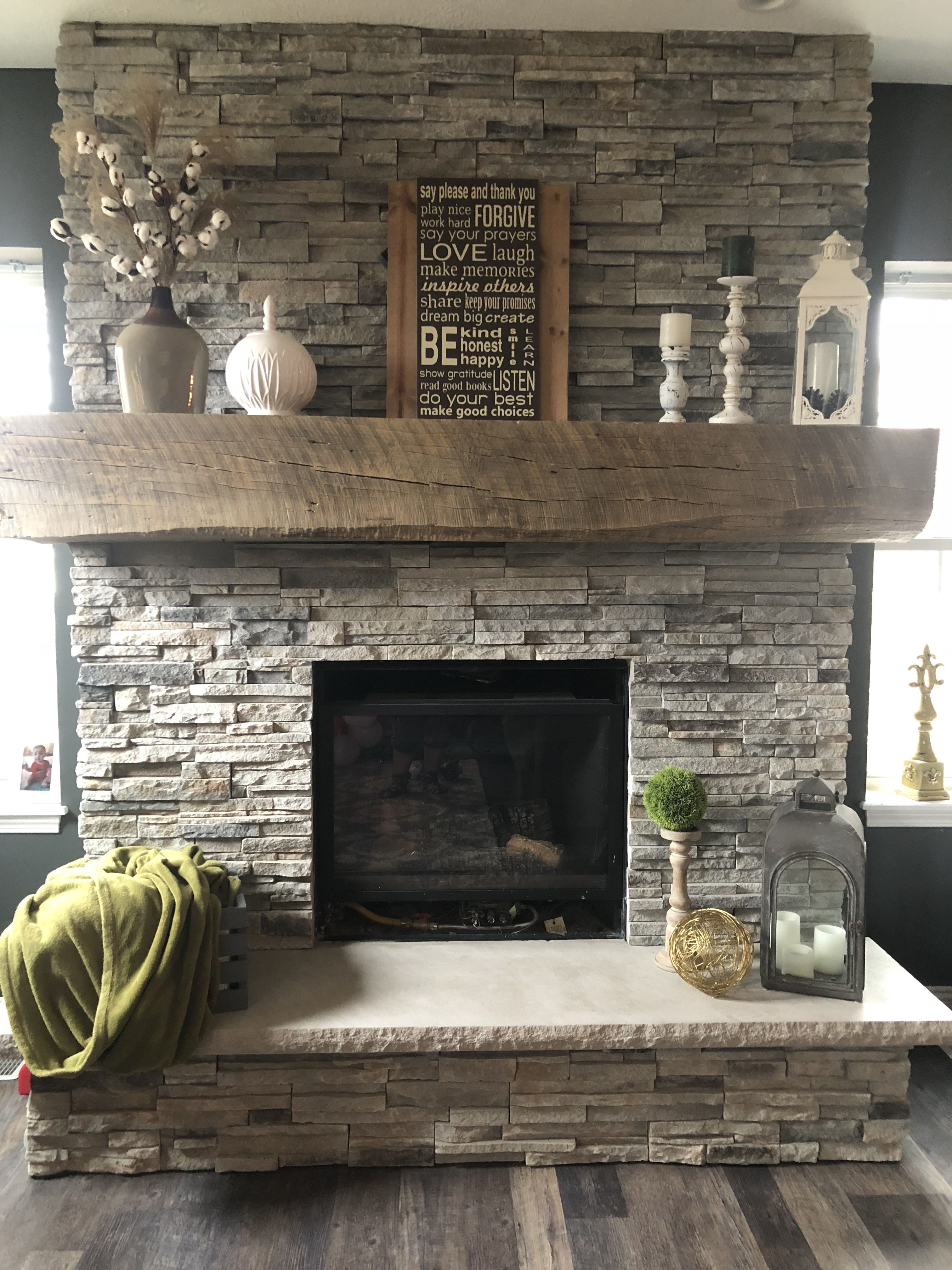 Stone fireplace with barn mantle Farmhouse fireplace