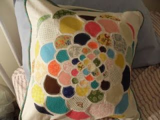 Rae made this adorable pillow.  I can barely sew a button on, so this is an admirable feat in my eyes.