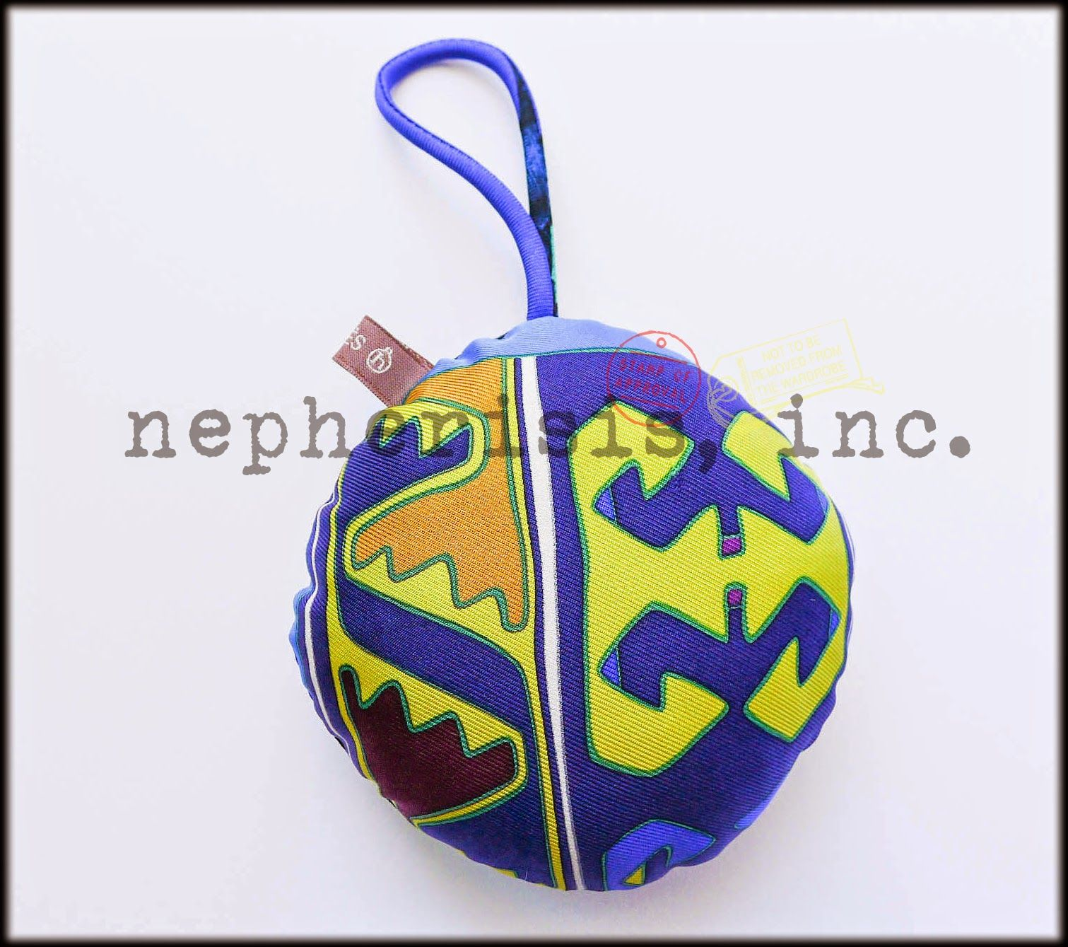 Hermes silk ball ornament or bag charm. New condition.