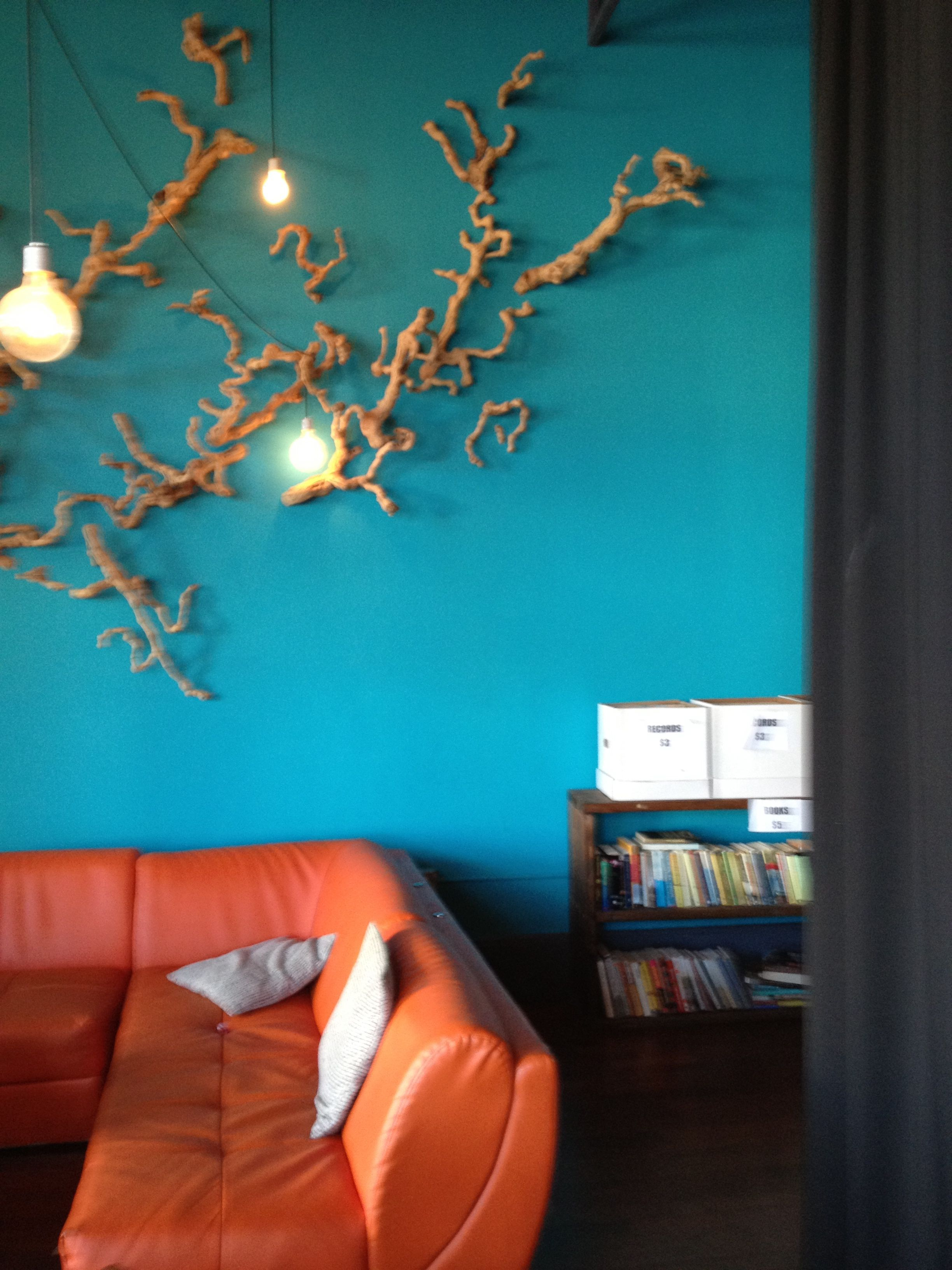 Teal Wall With Orange Couch At Vinyl Wine Bar In