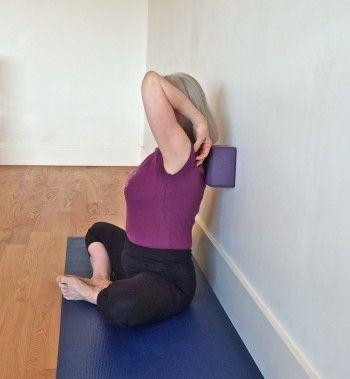 lean into a brick in baddha konasana  wall yoga yoga