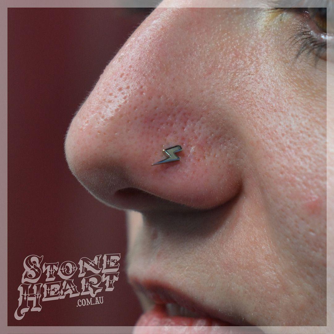 Healed up nose piercing  Fresh Nostril piercing with kt solid white gold Lightning bolt