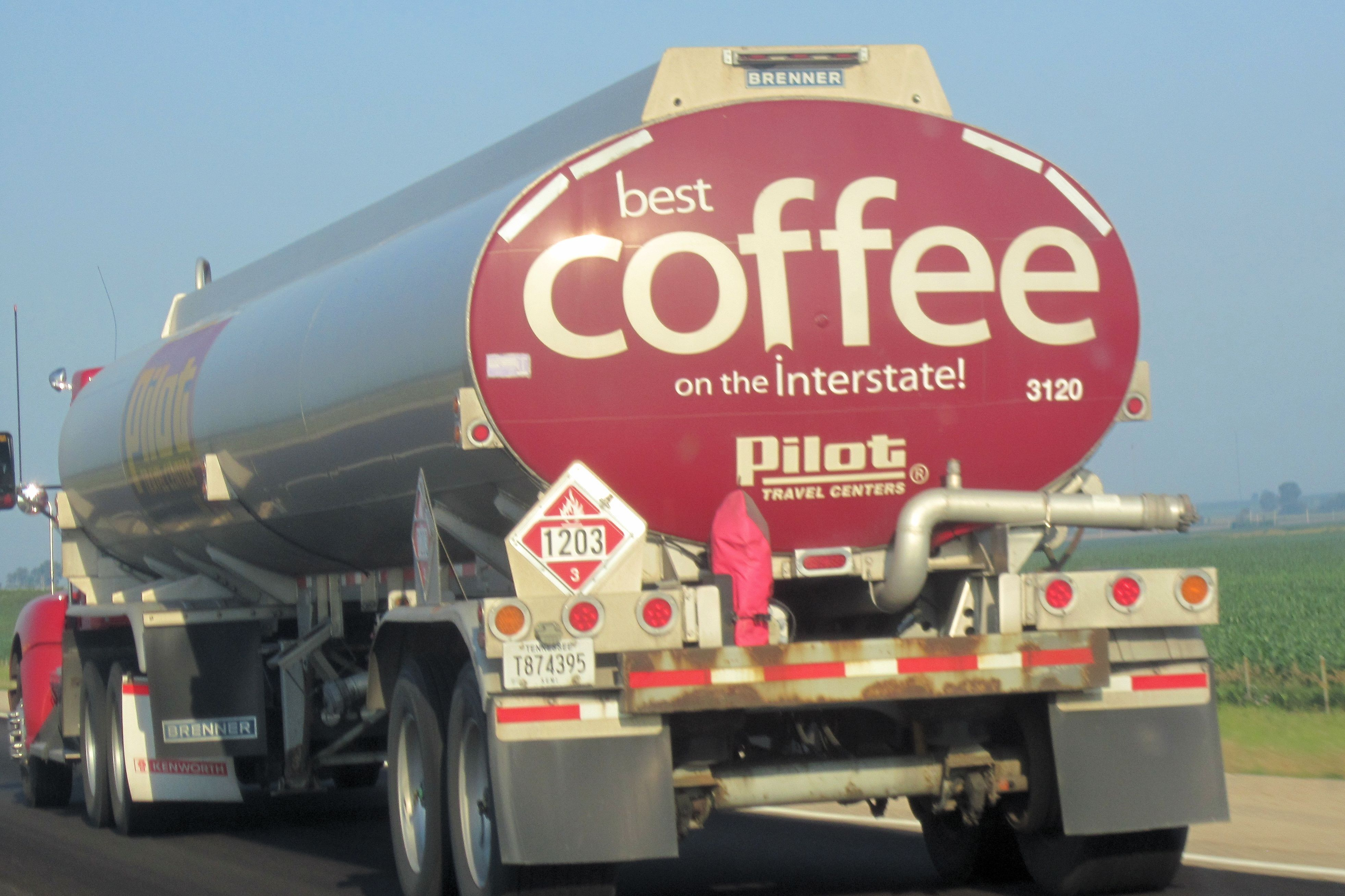 Tanker truck on the highway with a best coffee on the