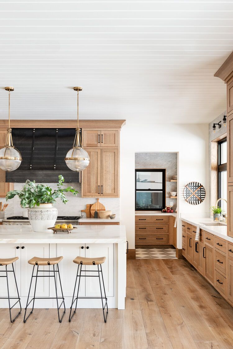 Today, we're excited to share our latest kitchen design, inspired by natural elements, juxtaposed materials, and industrial accents. In this space, we focused on playing to the beautiful natural wood on the cabinets to create an organic and traditional feeling with a modern twist. While we love painted cabinets, there's something about untouched materials that feels timeless, natural, and slightly undone.