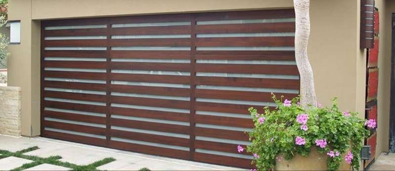 El moderno contmporary wood garage door and vertical white el moderno contmporary wood garage door and vertical white laminated glass planetlyrics Gallery