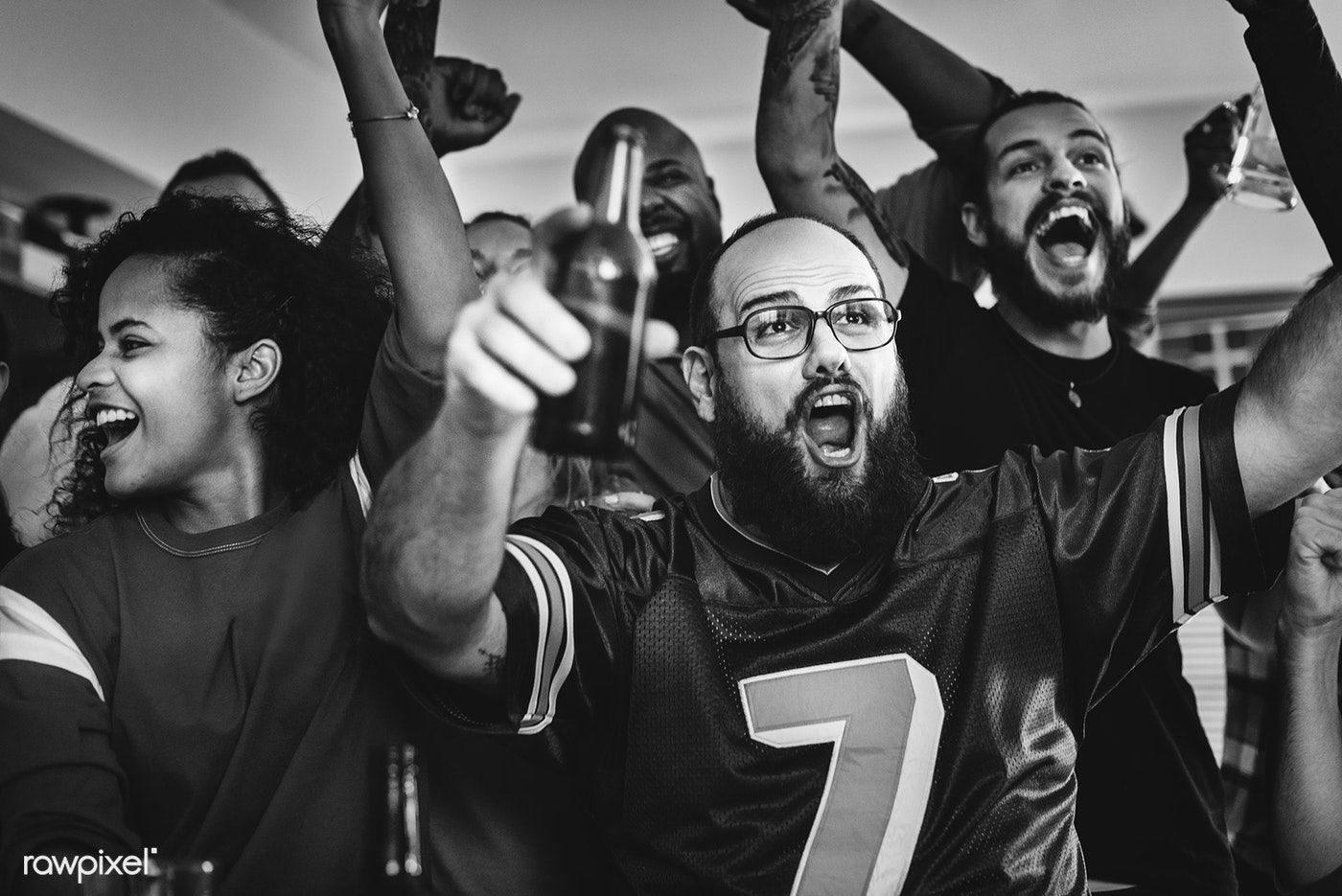 Download premium photo of Friends watching sports at a bar