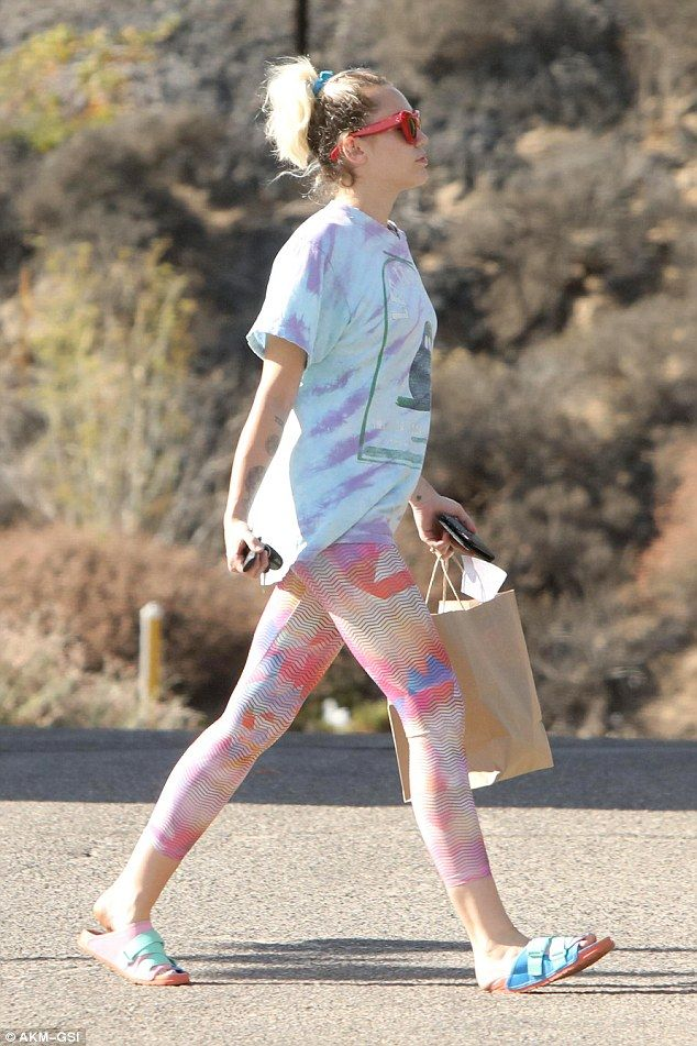 Catty:Completing the former Disney star's attire was a tie dye shirt and crazy cat eye sunglasses