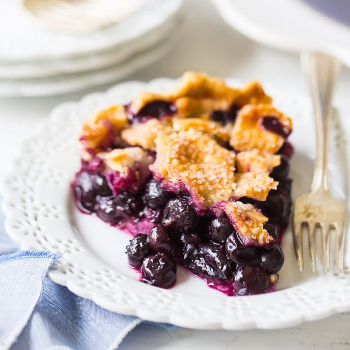 Homemade Blueberry Pie with blueberry pie filling made from fresh or frozen blueberries encased in a flaky pie crust