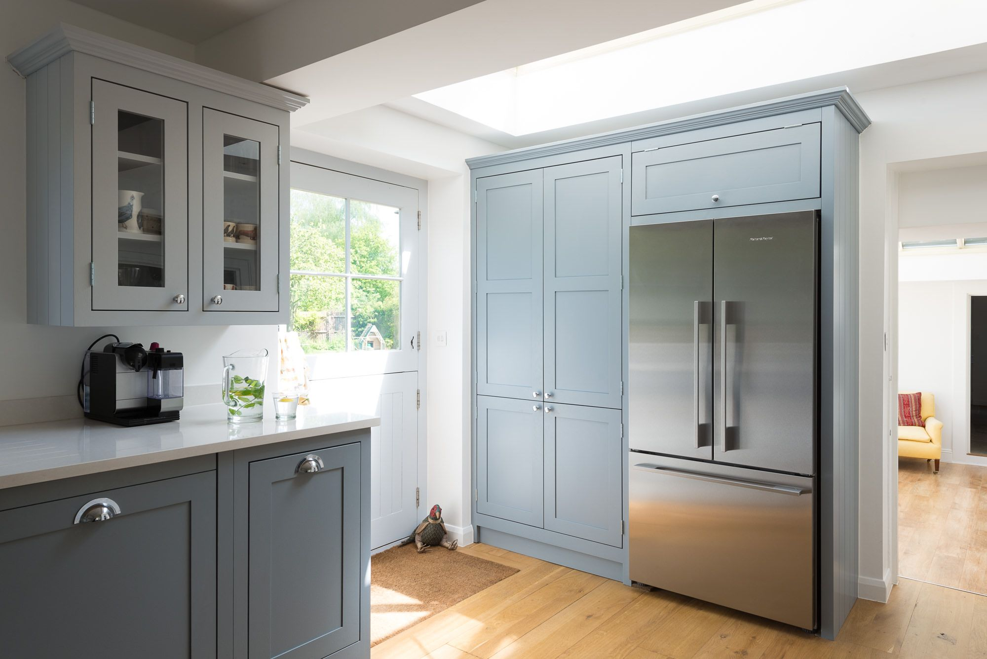 This pretty kitchen is hand painted in pale blue and white