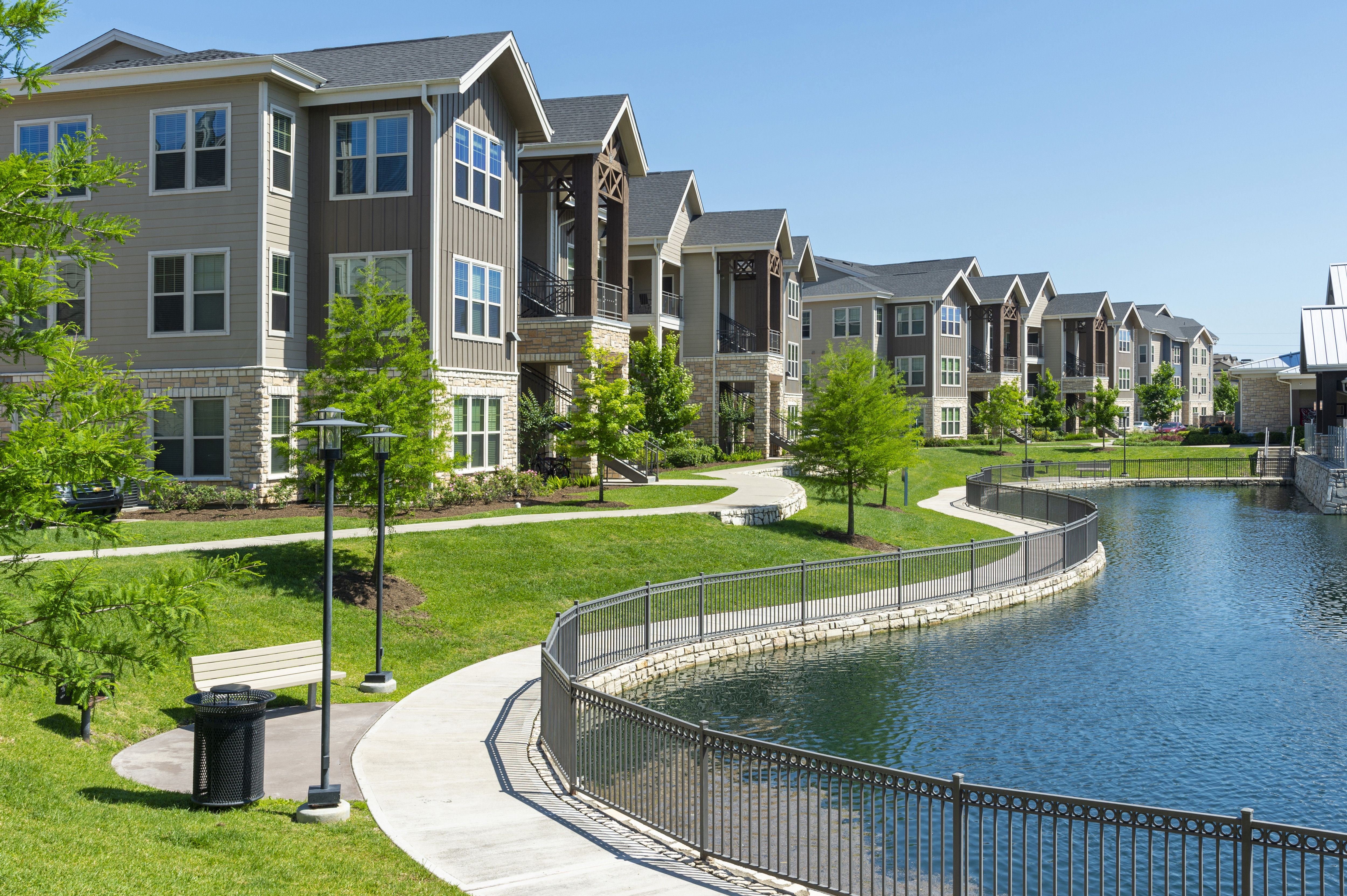 The Paths That Line The Lake Here At Aliso At Briar Forest In Houston Houston Apartment Houston Luxury Luxury Apartments